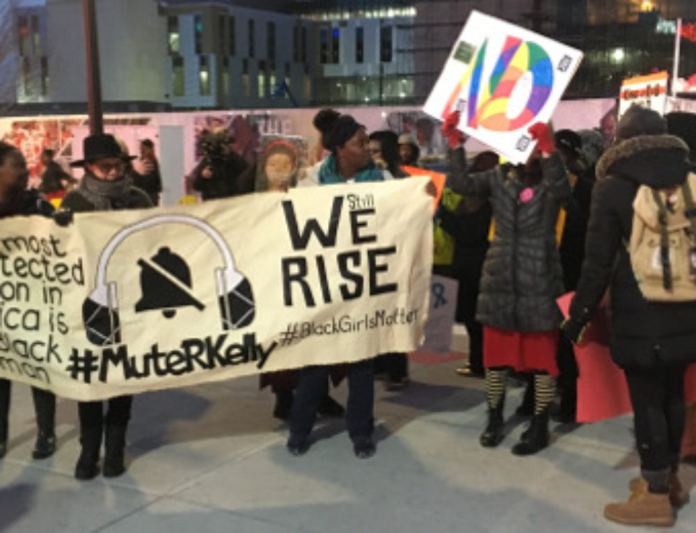 #MuteRKelly Protesters at LCA: 'Black Girls Lives Matter'