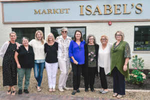 Isabel's Market & Eatery Co-Owner Garnet Lewis (center) stands in front of the shop with her business partners. Courtesy photo.
